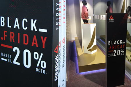 Decoración temporal de punto de venta Reebok para Black Friday