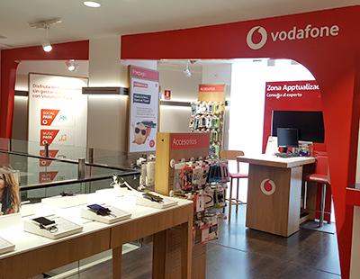 Produccion en madera y metacrilato para tiendas Vodafone